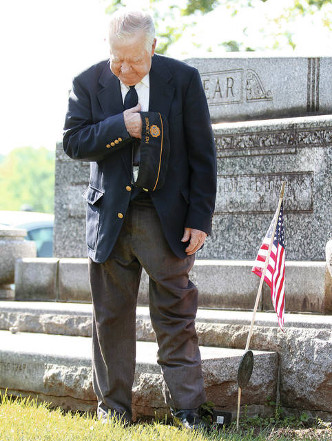 American Legion Post 217 member and World War II veteran Carl Zimmerman bows his head in prayer during the 2018 Memorial Day ceremony held at Graceland Cemetery.