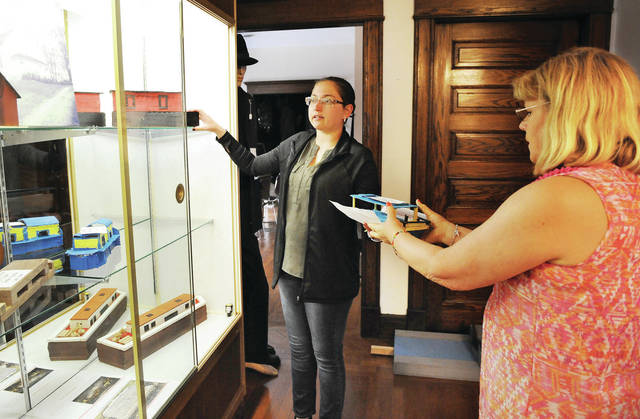 Shelby County Historical Society Curator Jane Bailey, left, of Fort Loramie, and Shelby County Historical Society Director Tilda Phlipot, box up historically themed pieces made by Hardin-Houston students that will be displayed at the Jackson Center United Methodist Church as part of the Jackson Center Community Days. The display will be up Saturday, June 1, from noon to 7 p.m.