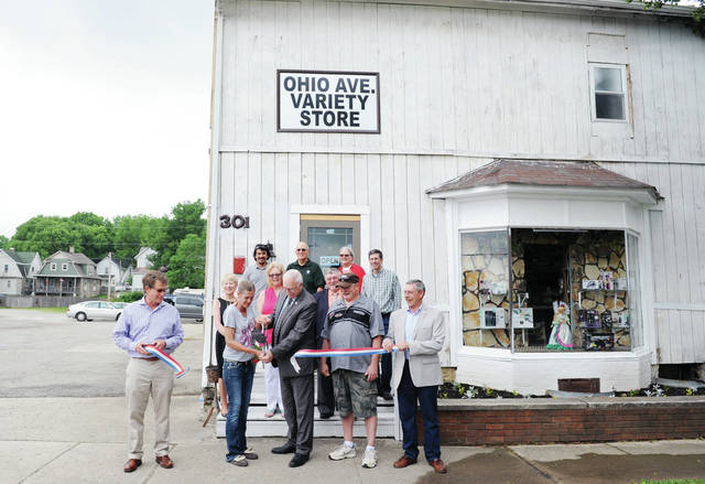 Stacey Donaldson and Sidney Mayor Mike Barhorst cut the ribbon on the new Ohio Avenue Variety Store that Stacy Donaldson has opened with her husband, Doni Donaldson, right of Barhorst.