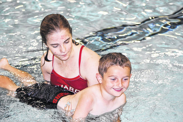 Sidney-Shelby County YMCA lifeguard Lily Schaeffer, of Fletcher, helps Ethan Baker learn how to move his arms in the water while holding his breath during the 2018 Water Safety Program. Ethan is the son of Rick and Emily Baker, of Fletcher. This year's program will be held June 3-6 at the YMCA. The Sidney Daily News, in cooperation with Minster Bank, Ruese Insurance and Frickers, are sponsors of the program.
