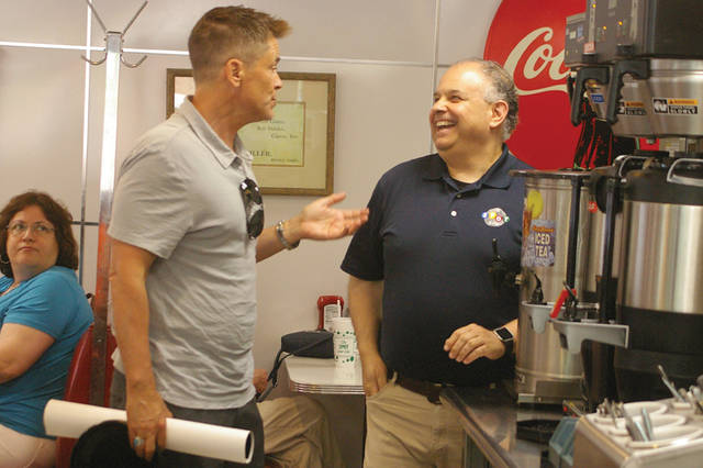 Actor Rob Lowe, center, talks to The Spot owner Michael Jannides, right, during a visit to Sidney on Friday. Lowe's grandfather Bob Hepler owned The Spot for 50 years.