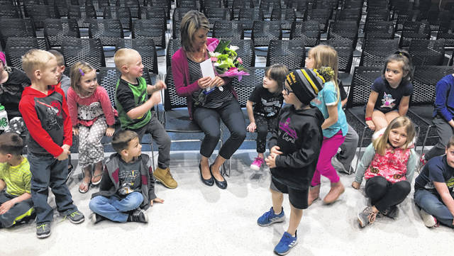 Botkins Local School kindergarten teacher Ashlee Zimpfer celebrates with her students after being named a Sidney Rotary Excellence in Education program winner Tuesday.