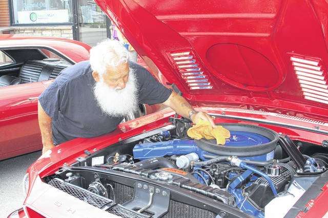 Clark Evans, of Logan County, makes final preparations prior to judging at the Jackson Center Community days Car Show in 2018. The village will again sponsor a car-bike-truck show on Saturday June 1. More than 200 participants are expected to attend. JC Community Days will be held May 30 to June 2 and offers a great variety of fun, food and entertainment for all ages.