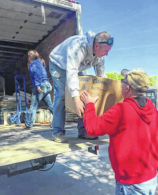 Brad Lentz and volunteers unload donated supplies as part of flood relief effort in Hamburg, Iowa.