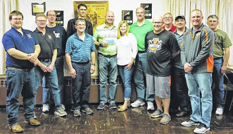 Knights Members pictured with Scott and Shelly are, from left to right, Matthew Albers, Roger Rutschilling, Jeff Dues, Pat Timmerman, Patrick Liening, Tim Bertke, Matt McDermitt, Kevin Steinemann, Dave Heckman, Adam Olberding, and Rick Riethman.