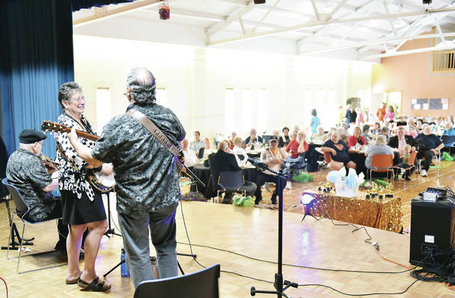 The Rum River Blend band performs during Senior Citizen's Day at the Sidney-Shelby County Senior Center Tuesday, May 7.