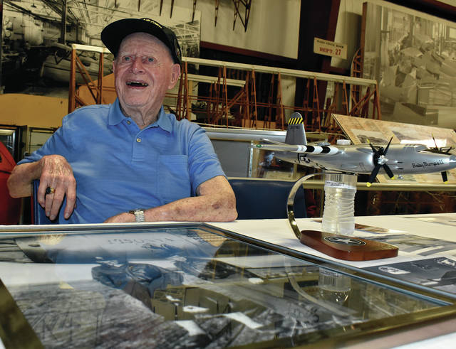 World War II and D-Day veteran Bill Deam of Sidney chats with visitors to the WACO Museum and Aviation Learning Center on Thursday, the 75th anniversary of the D-Day landings at Normandy. Deam was a B-26 Marauder pilot who flew bombing missions over German-held territory on D-Day. ©2019 Miami Valley Today