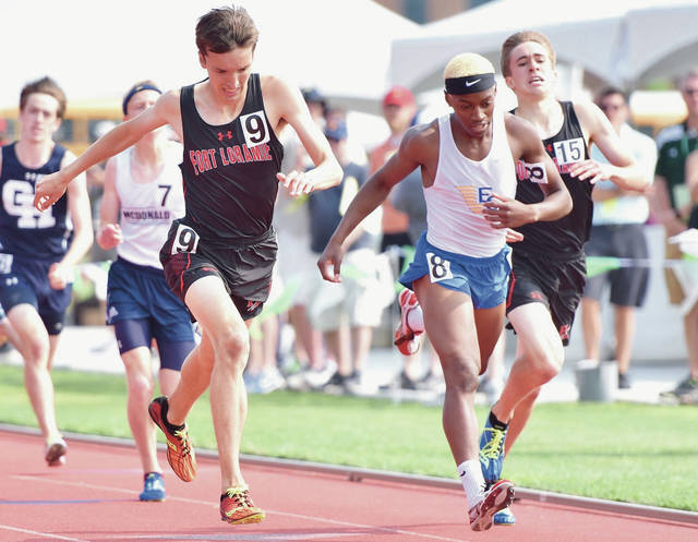 Fort Loramie's Jake Rethman, far left, crosses the finish line during the Division III boys 1,600-meter run shortly before teammate Joe Ballas, far right, during the state track and field meet on Saturday at Jesse Owens Stadium in Columbus. Rethman finished first in the event while Ballas finished third.