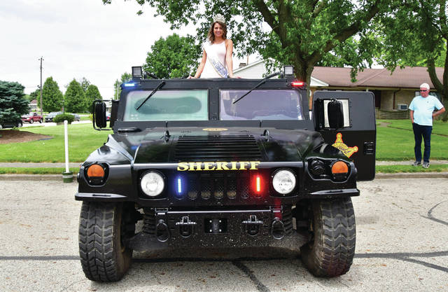 2019 Botkins Carousel Queen Kinley Topp, Sponsored by FFA, 17 year old daughter of Keith and Kindra, sits on top of a Shelby County Sheriff's Office Humvee at Botkins Carousel Saturday, June 8.