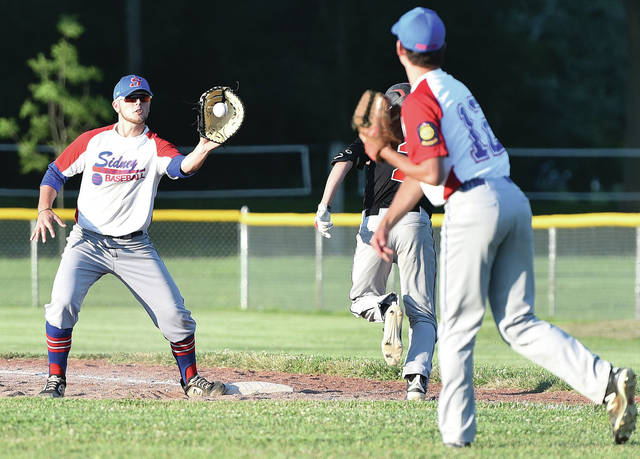 Sidney Post 217 first baseman Kyle Noble catches a throw from pitcher Zach Griesdorn to force out Troy Post 43 second baseman Kyle Evans at first during an American Legion game against on Tuesday at Custenborder Field in Sidney.