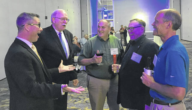 Local mayors enjoy a lighter moment at the annual conference of the Mayors Association of Ohio, including (left to right) Celina Mayor Jeff Hazel, Sidney Mayor Mike Barhorst, Bellefontaine Mayor Ben Stahler, Urbana Mayor Bill Bean, and Fort Loramie Mayor Randy Ahlers.