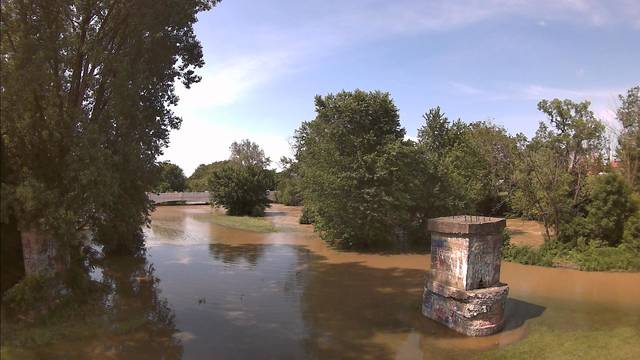 Water was beginning to recede on Wednesday morning near Custenborder Field after the Great Miami River reached flood stage. Both with more rain expected in the evening into Thursday morning, the river could rise again.