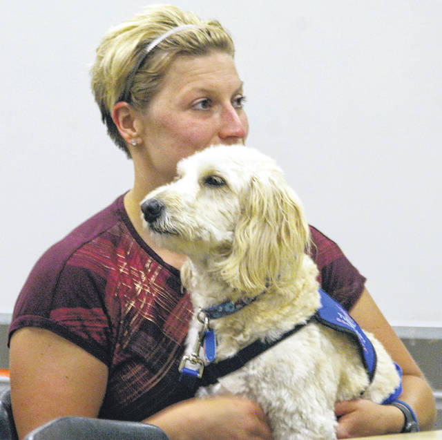 Tonya Slonaker, who was approved as a Sidney High School school counselor during Monday's Sidney Board of Education meeting, holds Stanley, a 3-year-old mini goldendoodle. Stanley is entering his second year as a therapy dog, having served with Slonaker at Fairlawn last year.