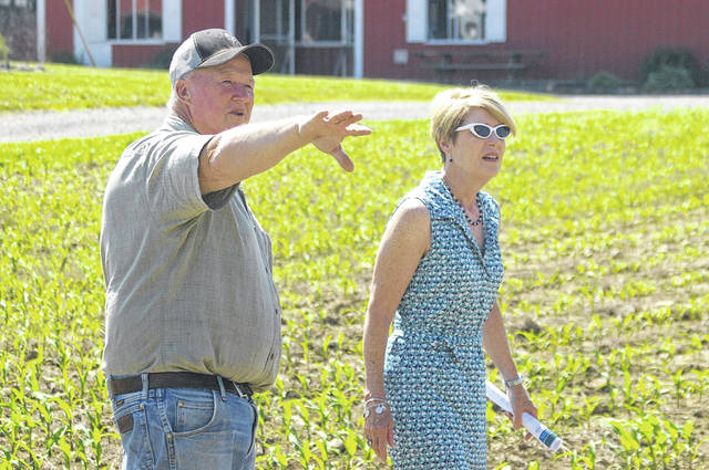 Farmer Doug Henry, left, shows Director of the Ohio Department of Agriculture Dorothy Pelanda his fields Friday morning near West Liberty.