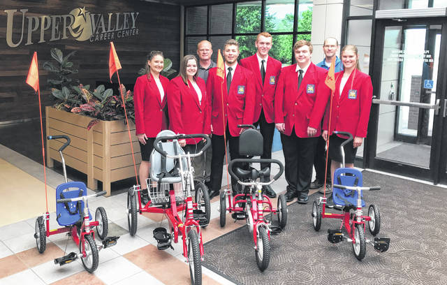 Upper Valley Career Center SkillsUSA local officers, along with Supervisor Roger Voisard and Adviser Jeff Bertke, display bicycles from a recent service project for the Miamibucs.