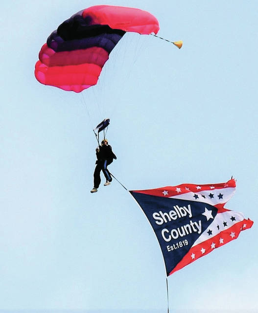 Michael Canary, from Skydive Green Co, Xenia, floats in the Shelby County Bicentennial Banner Friday, May 31, in Jackson Center during the Community Days celebration.