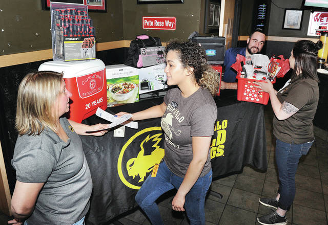 Looking at bicentennial raffle tickets and prizes are left to right, Sidney Buffalo Wild Wings, regional manager Darcy Bruns, of Troy, bartender Arielle White, of Piqua, service manager Justin Weber, of Troy, and event manager, Erin Symonds, of Sidney.