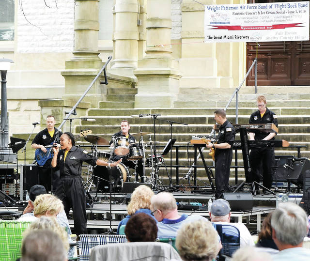 The Wright Patterson Air Force Band of Flight Rock Band Concert performs on the courtsquare Friday, June 7. The performance was part of the Shelby County bicentennial celebration.