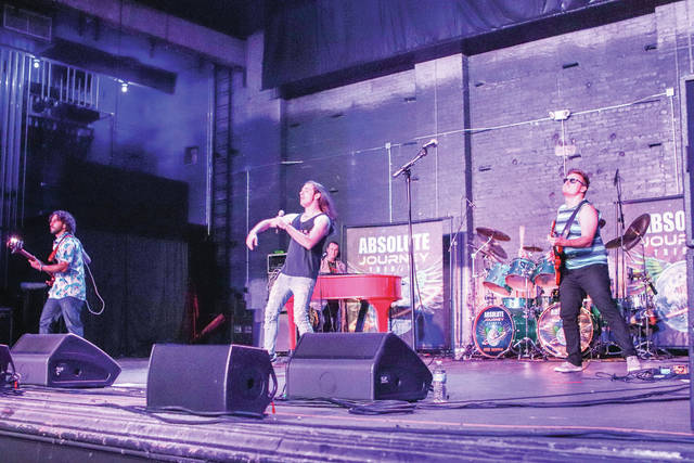 Absolute Journey Tribute performs at the Historic Sidney Theatre for 2019 Backstage Block Party on Saturday, June 15. The performance was held indoors due to rain.