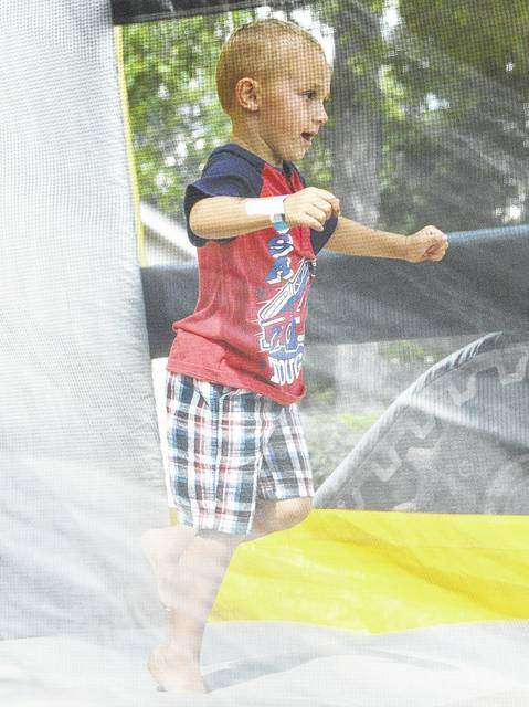 Wyatt Wellman, 4, of New Knoxville, son of Jaime and Jack Wellman, plays in a bounce house at New Knoxville Independence Day on July 1, 2018.
