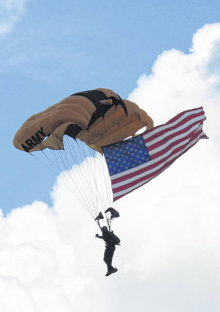 An Army Golden Knight in the sky during the 2019 Dayton Air Show.