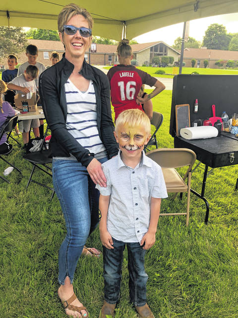 Tate Stachler, and his mom, Ashley, attended the Live Life Out Loud celebration Sunday.