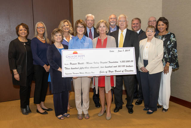 Officials representing Premier Health, its hospitals and its foundations accepted a check for $353,200 from representatives of the Gala of Hope Foundation on June 7 at the Premier Health Center in Dayton. Pictured are, front row, l-r, Duanna Osting, president, UVMC Foundation; Mary Boosalis, president and CEO, Premier Health; Barbara Mills, co-founder, Gala of Hope Foundation; Phillip Black, board member, Gala of Hope Foundation; Diane Ewing, chief liaison to the president and CEO, Premier Health; Kim Belcastro, chair, Miami Valley Hospital Foundation Board of Trustees; back row, l-r, Barbara Johnson, system vice president and chief human resource officer, Premier Health; Lori Scalise, vice president of service integration for cancer services, Premier Health; Jenny M. Lewis, president and CEO, Miami Valley Hospital Foundation; Mike Maiberger, executive vice president and chief operating officer, Premier Health; Tom Parker, president, Upper Valley Medical Center; Mike Stautberg, president, Atrium Medical Center Foundation; and Mike Sims, system vice president, treasurer and corporate controller, Premier Health.