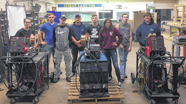 Several Indian Lake High School students pose on the final day of classes with the donated welders from Lacal.