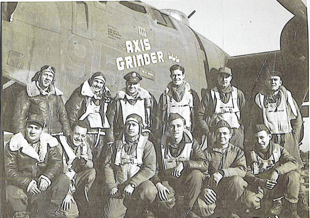"""Don Williamson was a pilot on a B-24 Bomber during World War II. They were on a mission to Berlin when this photograph was taken. Crew members were, back row, left to right, Sgt. Fred White, Maj. William Taylor, Capt. Mel Graper, Lt. John Johns, Capt. Harold """"Doc"""" Weiland and Sgt. Walt Kolczynski; and front row, St. James Buzick, Sgt. Don Cordick, Sgt. Bill McKinley, Sgt. Bill Lorenzen, Lt. Don Williamson and Lt. Rapenport, who was the lead navigator on the mission."""