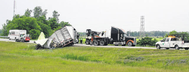 A semitrailer is being pulled upright by Mantor Towing after rolling onto its side on the Fair Road exit of Interstate 75 at mile marker 90 Tuesday, June 4, around 9 a.m. According to OSP, the truck driver was driving too fast and lost control, causing the vehicle to rollover onto its side.