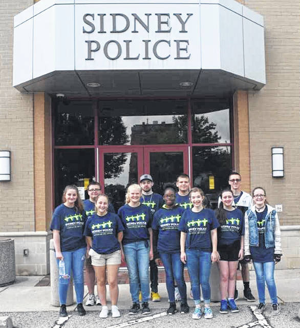 Pictured is Class 003 of the Sidney Police Teen Law Enforcement Workshop. The students graduated the during the last week of May.