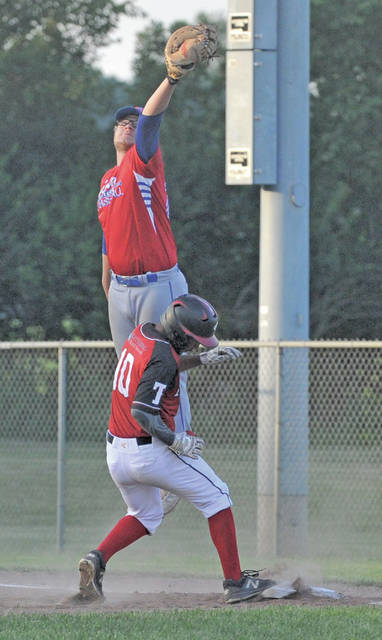 Sidney Post 217's Bryce Kennedy goes up for a catch while Troy Post 43's Darius Boecke tries to make it back to first base to avoid a double play after a lineout during a game on Tuesday in Troy.