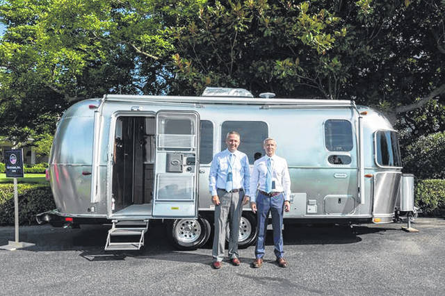 Bob Wheeler and Justin Humphreys show their Airstream camper on the South Lawn of the White House, a product of the Airstream, Inc. in Ohio, Monday at the Made in America Product Showcase event held at the White House.