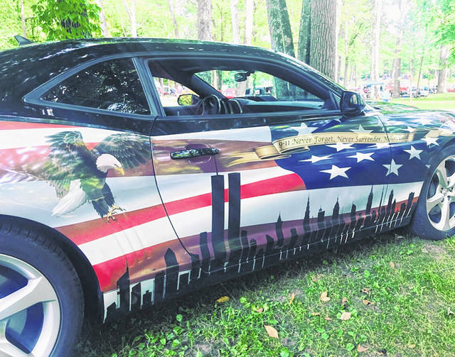 A 2014 Chevy Camaro SS sits on display during the Anthony McLain Cruise-In Saturday, June 29 at Tawawa Park. As the nation prepares for the Fourth of July celebration, the car provides a patriotic message reminding people to never forget the attacks on 9/11.