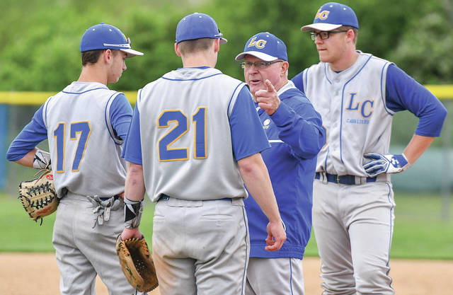 Lehman Catholic coach Dave King, middle right, talks to Jared Magoteaux during a Division IV district semifinal on May 21 in Casstown. It was the final game for King, who is retiring after 40 seasons as a baseball coach.