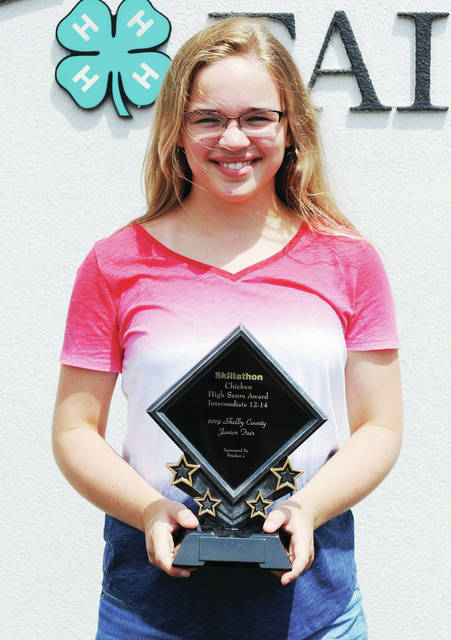 Amy Briggs, 12, of Sidney, daughter of Judy and Mark Briggs, a member of Thrifty Farmers, won high score award in chickens skillathon intermediate ages 12-14.