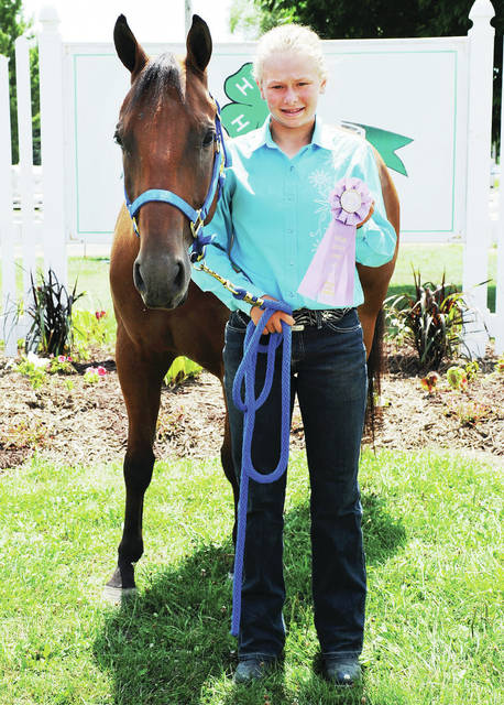 Kendall Reese, 12, of Jackson Center, daughter of Erin and Jeremy Reese, a member of Happy Trails 4-H Club, won reserve champion wester riding at the Shelby County Fair.