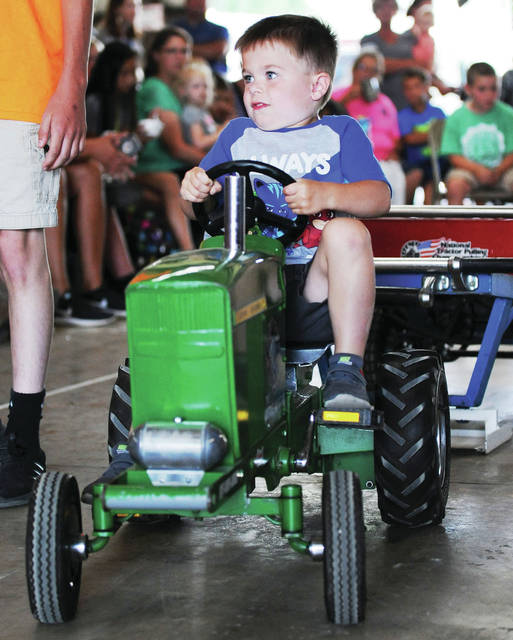 Daniel Young, 4, of Houston, son of Greg and Megan Young, competes in the kiddie tractor pull at the Shelby County Fair Thursday, July 25.