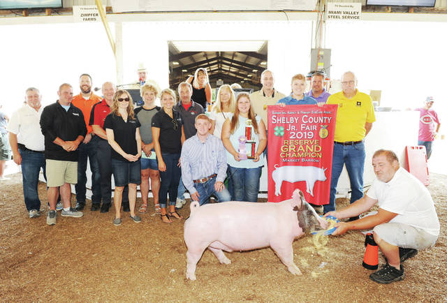 Evan Argabright, 19, of Jackson Center, daughter of Jennifer and Darren Argabright, a member of Anna FFA, sold her reserve grand champion market barrow at the Shebly County Fair on Friday, July 26. It sold for $3,500 and was purchased by 23 buyers.
