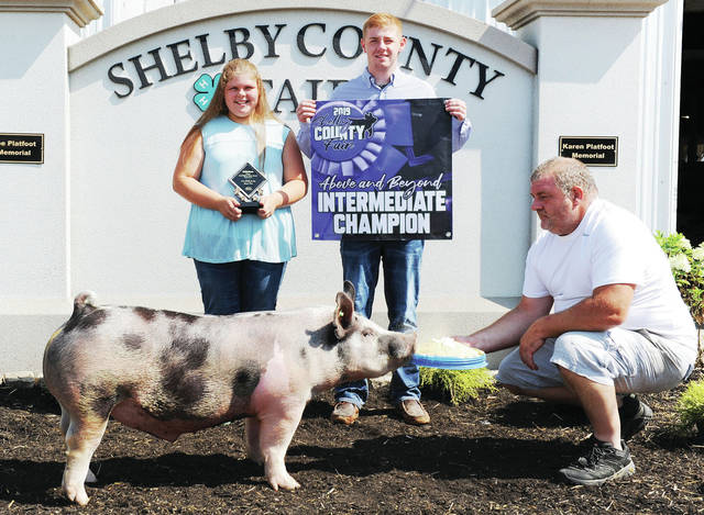 Marin Argabright, left, 11, of Jackson Center, daughter of Darren and Jennifer Argabright, won above and beyond award and skillathon second place, at the Shelby County Fair. With her are her brother Evan Argabright, 19, and dad, Darren Argabright.