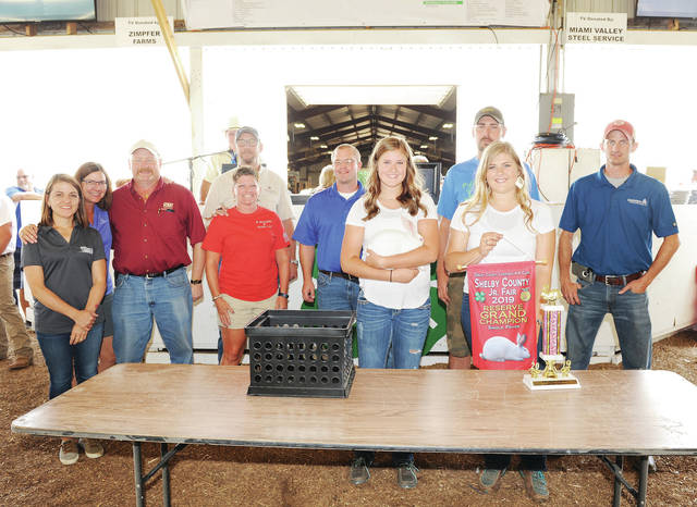 Jenna Batton, 14, of Sidney, daughter of John and Kristen Batton, a member of Successful, sold her reserve grand champion single fryer at the Shelby County Fair on Friday, July 26. The fryer sold for $800 and was purchased by 12 buyers.