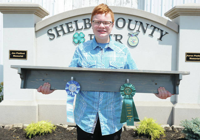 Thomas Birkmeyer, 15, of Houston, son of Jamie Birkmeyer, member of Merry Mod Makers, won best of class and state fair qualifier in measuring up : senior at the Shelby County Fair.