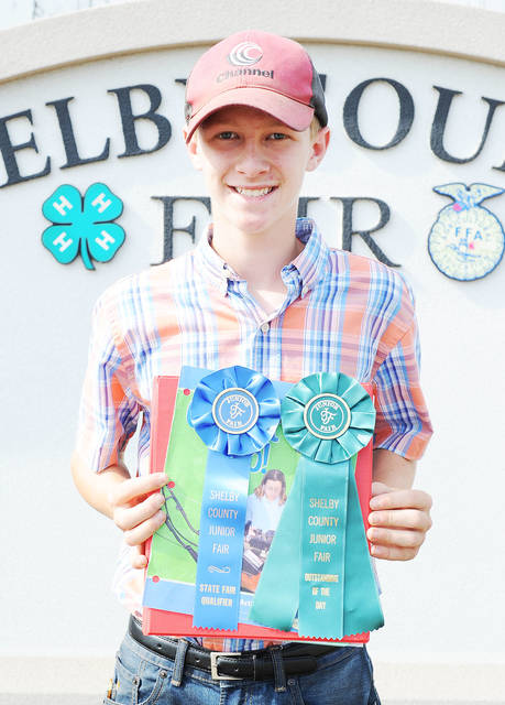 Levi Delaet, 13, of Russia, son of Chad and Ann Delaet, member of Russia Livestock, won outstanding of the day and state fair qualifier in small engines at the Shelby County Fair.