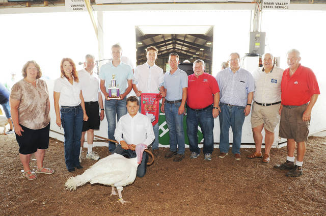 Colton Pleiman, 12, of Botkins, son of Jeremy and Lynn Pleiman, a member of Botkins Livestock, sells his reserve grand champion turkey at the Shelby County Fair on Saturday, July 27. The turkey sold for $550 and was purchased by 11 buyers.