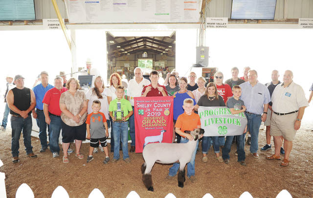 Brendan Serr, 9, of Jackson Center, son of Meghan and Garrett Serr, a member of Progressive Livestock, sells his reserve grand champion market lamb at the Shelby County Fair on Friday, July 27. His lamb sold for $5,190 and was purchased by 46 buyers.