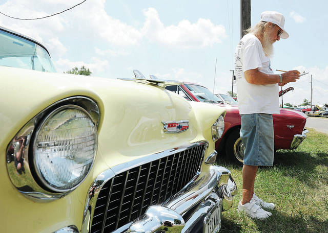 Bill Vance, of Piqua, helps judge the 23rd Annual Cruise In at the Shelby County Fair Sunday, July 21.