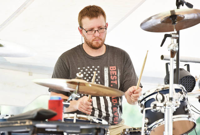Kyle Partin, of Union City, Ind., gets warmed up on his drums before performing with the band Haywired at the New Knoxville Independence Day Celebration Saturday, June 29.