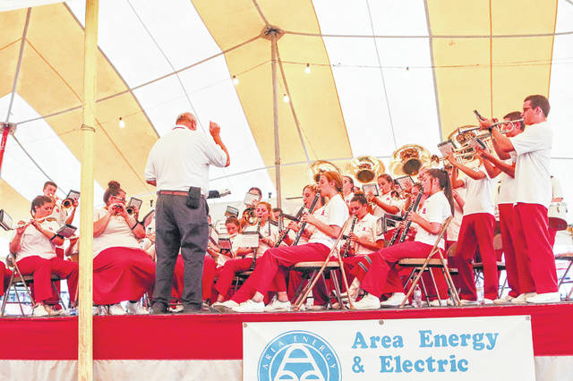 "After performing during the opening ceremony Sunday, the Houston High School band held a concert in the free entertainment tent at the Shelby County Fair. One of the selections they performed was ""Momma Mia."""