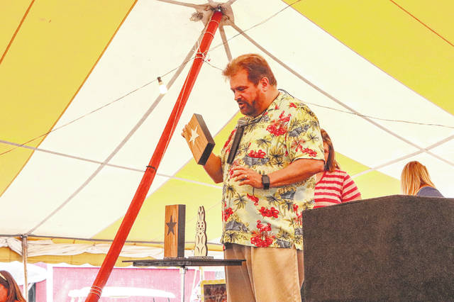Mike Bishop performs a magic show before the kids program started on Thursday at the Shelby County Fair.