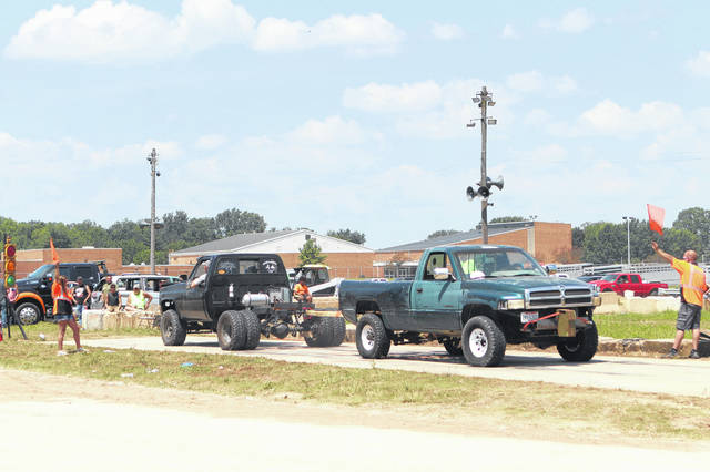 Drivers get ready to compete in the truck pulls at the Shelby County Fair.